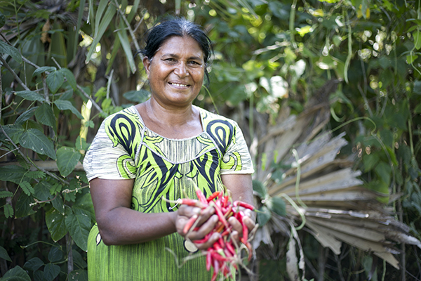 woman holds chili peppers in Sri Lanka