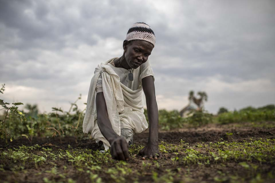 woman tends her crops in South Sudan