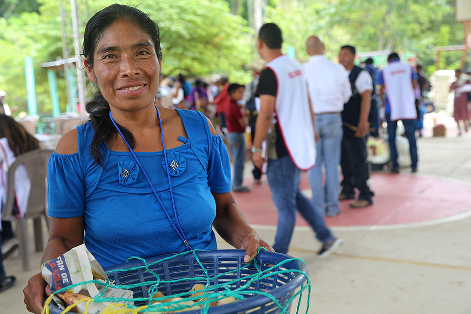 woman with chickens in Guatemala