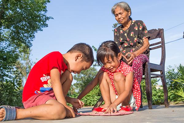 woman with grandchildren in Vietnam