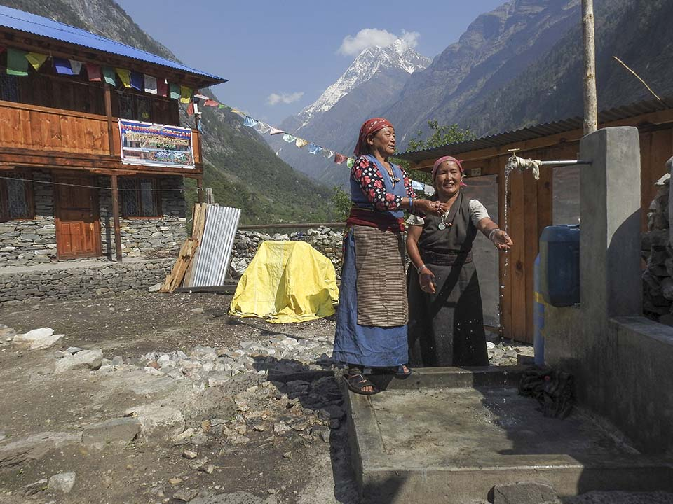 women at water tap in Nepal