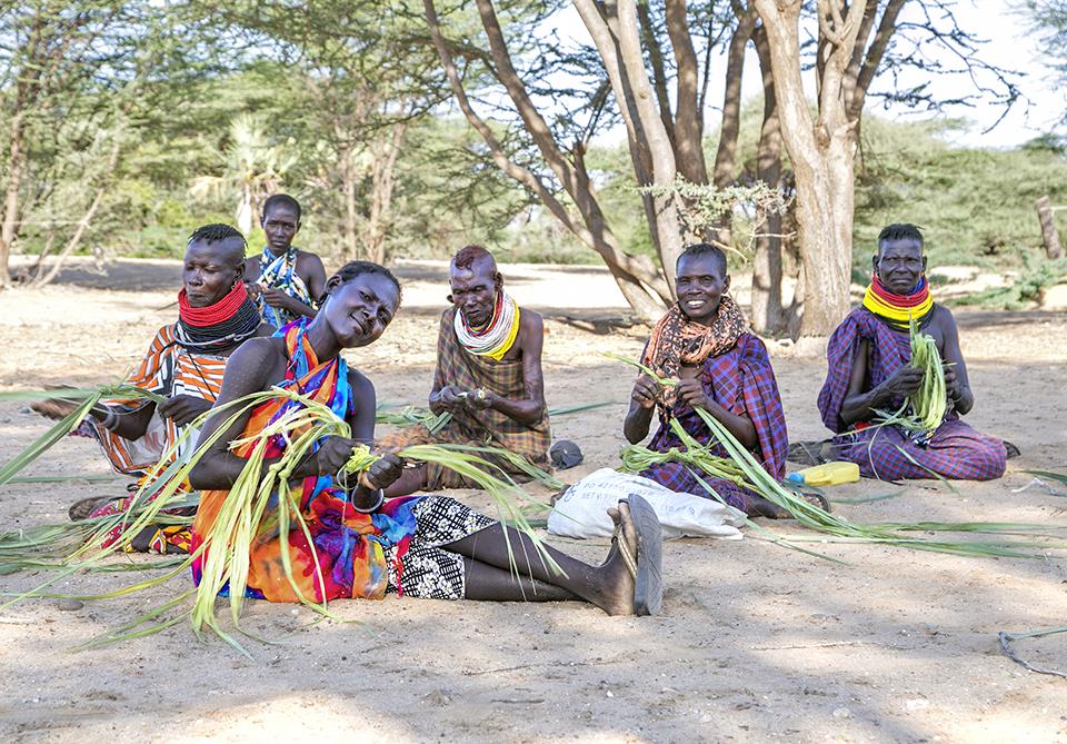 women weave leashes in Kenya