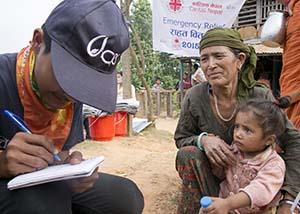 worker talks to earthquake survivor in Nepal