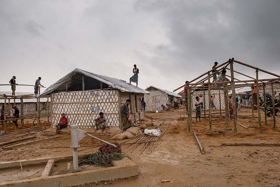 workers build shelters in a Rohingya refugee camp in Bangladesh