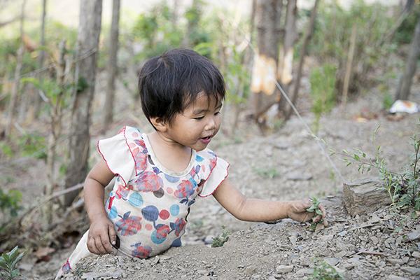 young child in myanmar garden
