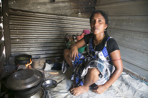 young mother in her kitchen in Sri Lanka