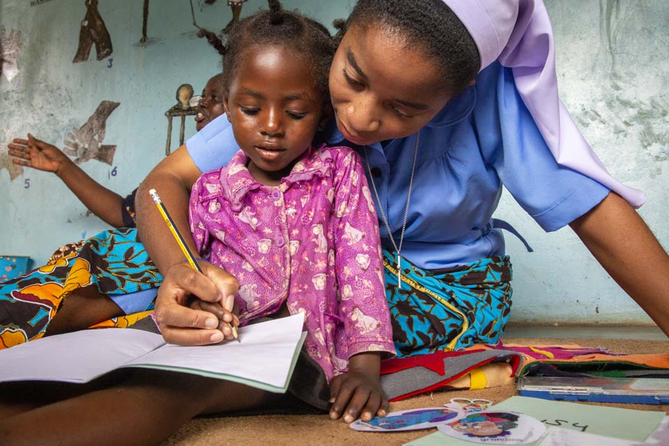 Zambia teacher and child