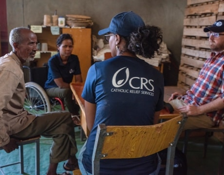 Farmer Thien Thi Phan (woman in dark green shirt throughout) participates in a CRS training on safe water.