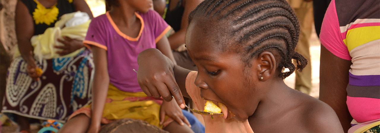 A child eats a nutritious meal in Africa. Photo by Michael Stulman/CRS