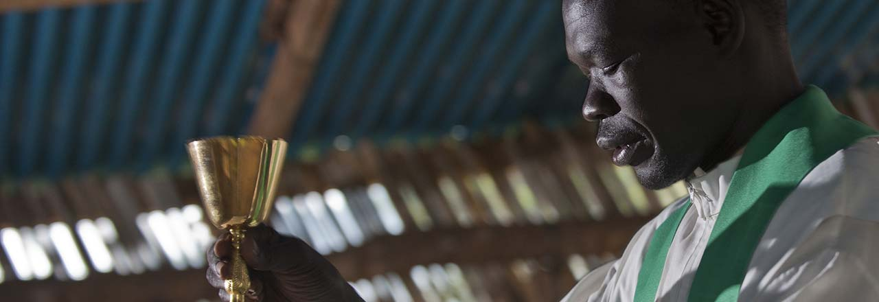 priest saying mass in South Sudan