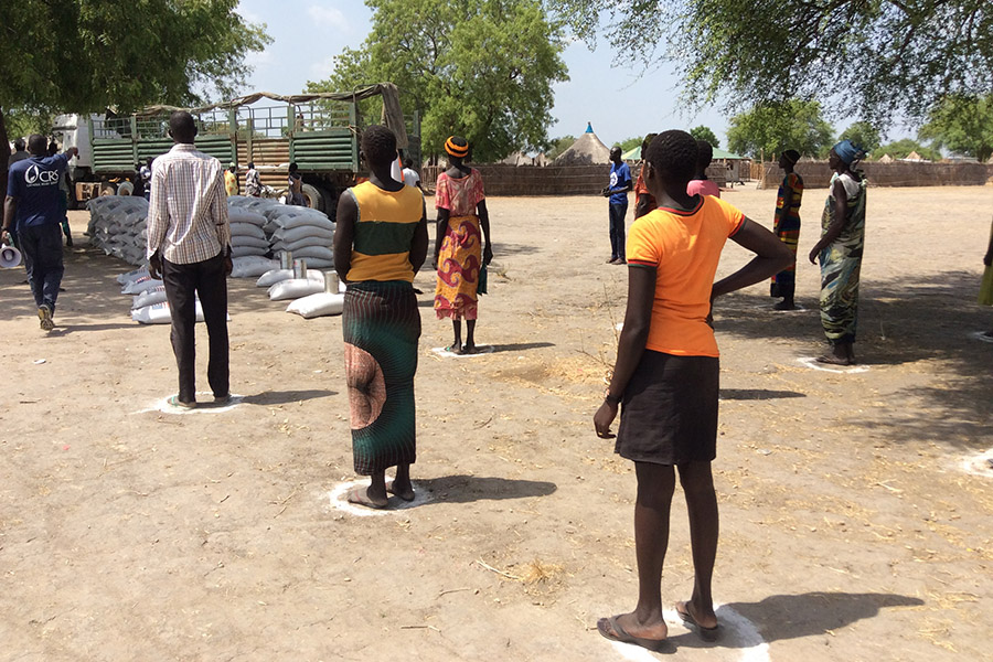 People in South Sudan practice social distancing while waiting to receive food rations