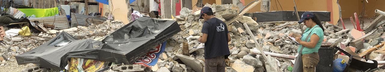 workers survey quake damage in Ecuador