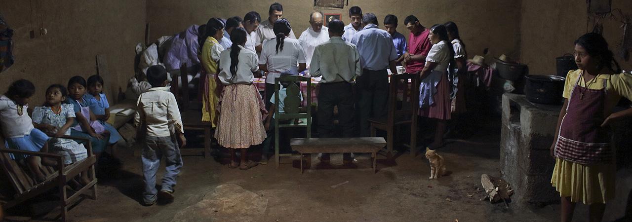 The Ramirez family prays in thanksgiving for God's provision.