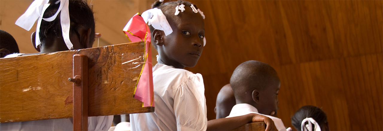 A mass baptism at the cathedral in Gonaives, Haiti. David Snyder for CRS