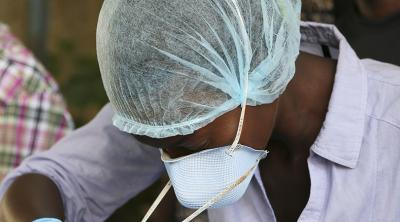 In response to the Ebola outbreak, CRS is training healthcare workers so they understand when and how to use protective medical equipment. Photo by Michael Stulman