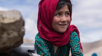 Afghan girl washing her hands