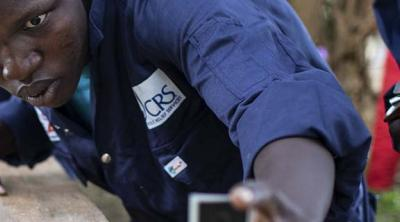 Uganda student checking board face for level