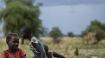 girl pumping water at a well in South Sudan