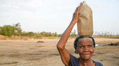 Woman from Madagascar carries a jug of water on her head