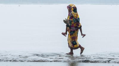 Mother walking to relief center in Bangladesh