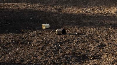 South Sudanese walks dry pond