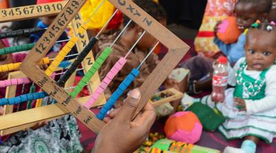 Parents learn to make toys for their children as part of CRS' THRIVE program. Photo by Philip Laubner