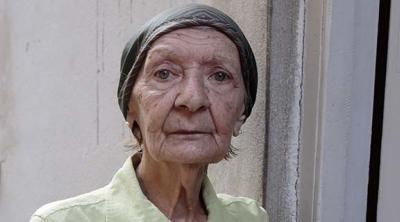 woman standing outside near a door in Cuba