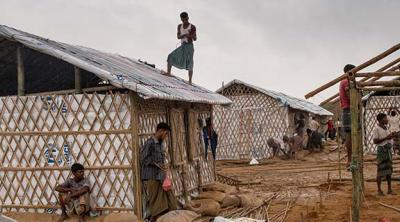 workers build shelters in a Bangladesh camp for Rohingya refugees