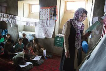 """""""I would like to raise these children to become good citizens one day. Despite their illiterate parents, I want them to be educated,"""" says a CRS-trained teacher in Afghanistan. Photo by Elie Gardner for CRS"""