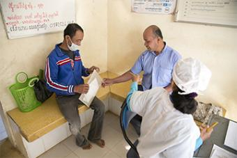 Sovanna accompanies Bung to each weekly checkup at the community health clinic. There, staff confirm Bung's progress and dispense a week's worth of medicine.
