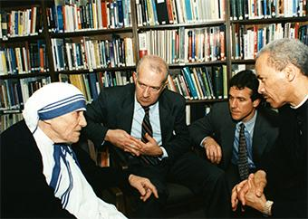 Our senior staff ((then-President Ken Hackett, Chief Operating Officer Sean Callahan—who served with her in India—and then-Board Chair Bishop John Rica) listen attentively to Mother Teresa as she visits CRS headquarters in 1996. Photo by CRS staff