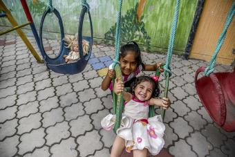 At a playground inside the Scalabrini Mission, kids can be kids. Photo by Ryla Simmons/CRS