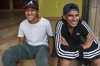 Two friends participate in the Youth for Peace program at the Scalabrini Mission. Photo by Ryla Simmons/CRS