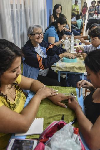 Women learn new trades at the Scalabrini Mission, including nail and hair styling. Photo by Ryla Simmons/CRS