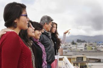 A Colombian family, in Ecuador for 9 months, looks out over their new city. Photo courtesy of Ruben Andrade