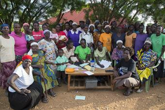 In THRIVE's final year, 3,824 parents and caregivers were involved in support groups.  In Tanzania, 1,555 were involved in Savings and Internal Lending Communities, which can improve their financial future. Photo by Sara A. Fajardo/CRS
