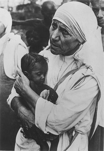 An infant finds comfort in Mother Teresa's arms in India.  Photo by CRS staff
