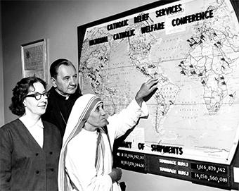 Mother Teresa is joined by longtime CRS staffer Eileen Egan and former CRS Executive Director Bishop Edward Swanstrom as they plan overseas food shipments.  Photo by CRS staff