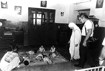 At a home for orphaned and abandoned children in Shishu Bavan, India, Mother Teresa watches over infants who would otherwise have been left to die. Photographed in 1975, these children would be 42-year-olds today. Photo by CRS staff