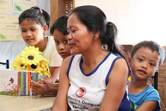 Josefa Alvero, and her two sons and niece were relocated from their coastal community. They now call a storm-resistant shelter built by CRS their home.