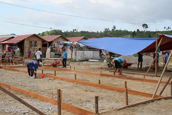 CRS is working with volunteers to construct recreational facilities, like playgrounds and basketball courts, so children have a place to play.