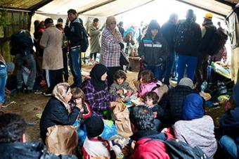 Refugees wait in one of 20 tents sheltering refugees at Vasariste. Doctors and translators are working with CRS and Caritas to provide basic medical services and information about the border crossing. Photo by Kira Horvath for CRS