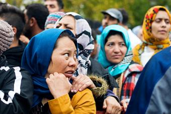 Refugees line up for a distribution of relief items in Belgrade. CRS is working with Church partners in Serbia—as well as Greece, Albania and Macedonia—to provide food, basic living supplies, and medical and legal support. Photo by Kira Horvath for CRS