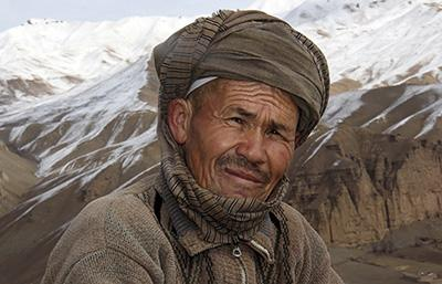 """Mohammad Esa, an Afghan farmer, takes a break from digging trenches in the Sareqol Valley. """"The main purpose of this work is to reduce disaster, and for the area to become green and to increase fodder for the animals,"""" he says. Photo by Nikki Gamer/CRS"""