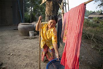 Household chores are difficult for Neoum, who lives with a physical disability that makes walking a challenge. Still, she welcomed her brother-in-law into her home, even though it increased her workload.