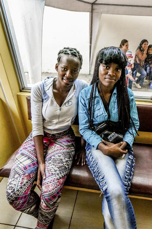 "Sisters Kelly Estefay Reyes and Brensi Bonilla: ""At a party [they] said that we should be burned because we are black and we are Colombian. They started the fire … and we thought they would really kill us."" Photo by Ryla"