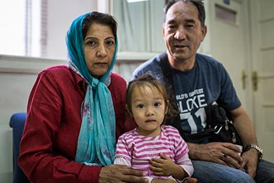 Sabriya and Ghullamali, with daughter Hasti, seek rest and refuge at the Caritas Athens Refugee Center on their way to Germany. Their two older children, both teens, traveled to Germany unaccompanied almost a year ago. The center is helping the family reu