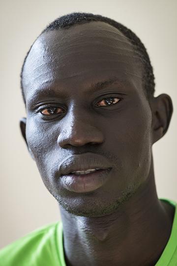 <b>James Chiengjiek<br />Sport:</b> Men's Track & Field (400m)<br /><b>Native Country:</b> South Sudan<br /><b>Host Country:</b> Kenya<br />Photo by IOC/Claire Thomas