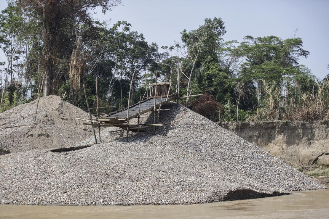 "Miners call this ""the beach."" Located on the river's edge, it is the leftover rocks, gravel and sand from the gold mining process. Photo by Oscar Leiva/Silverlight for CRS"