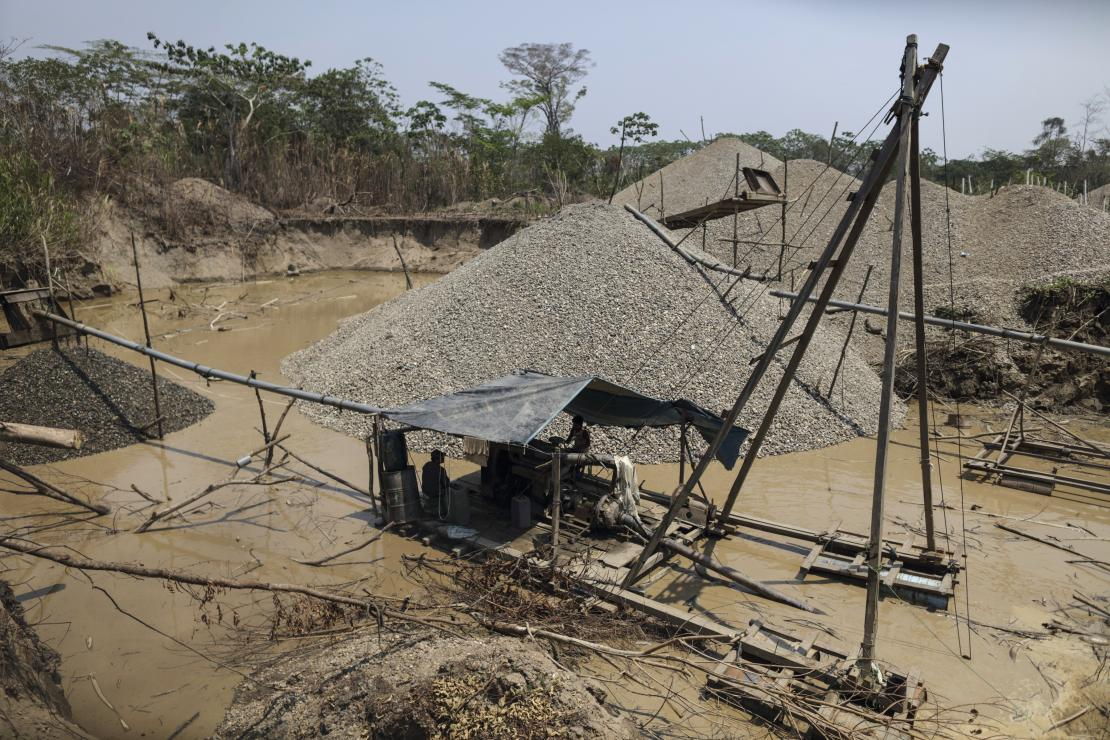 This is a mining rig in the Peruvian Amazon. The hills are what are left behind after the mining process. Photo by Oscar Leiva/CRS